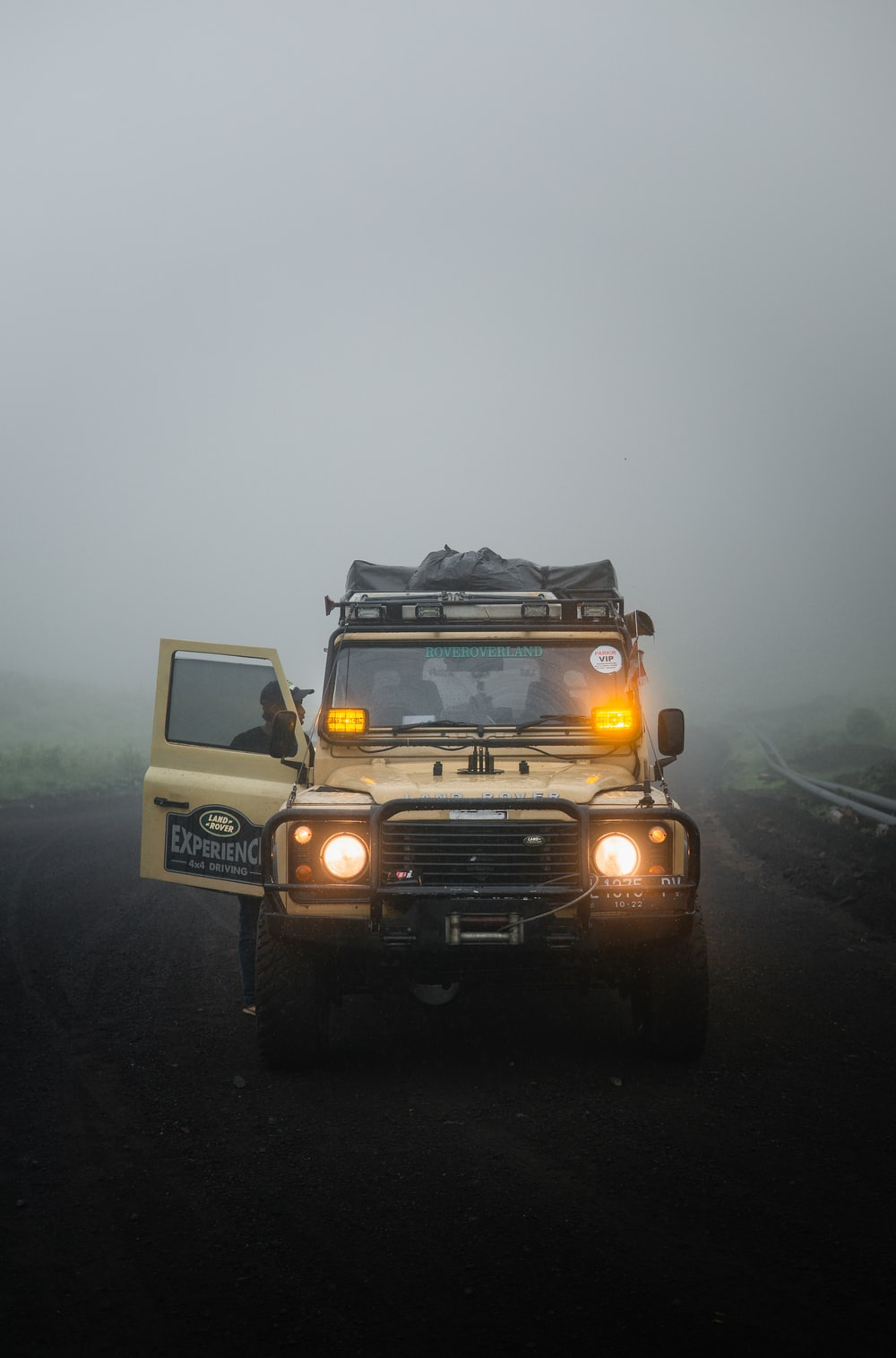 white and black jeep wrangler on road