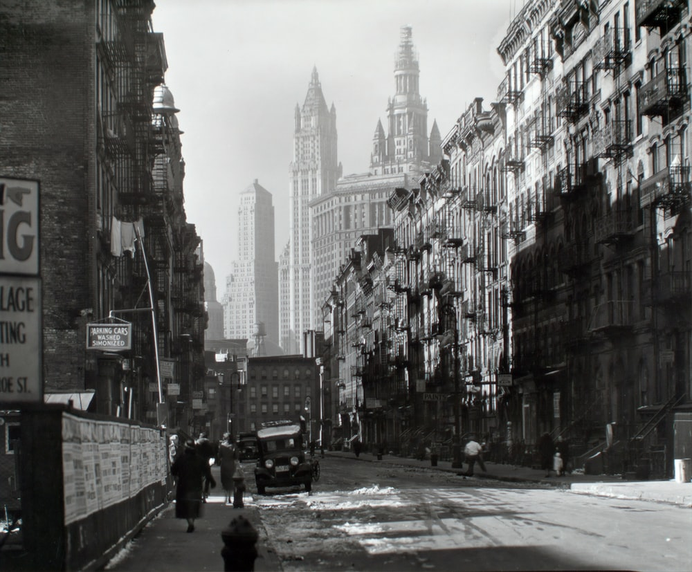 grayscale photo of city buildings in Manhattan