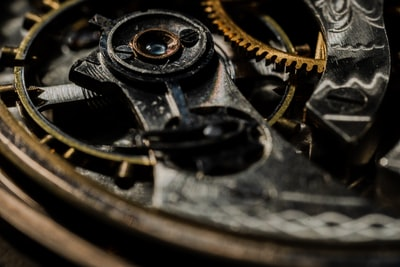 inside gears of an antique pocket watch