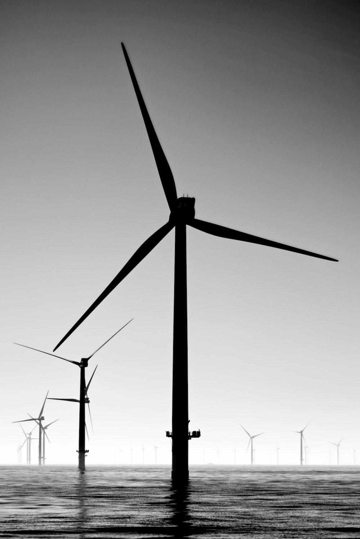 black wind turbines under gray sky