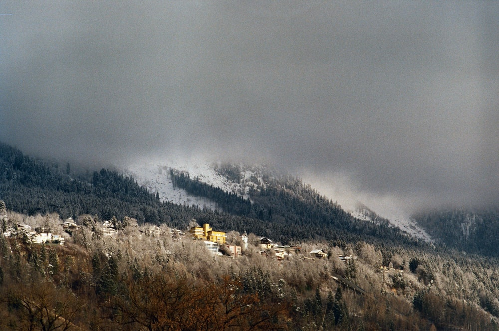 white and brown mountains under white clouds