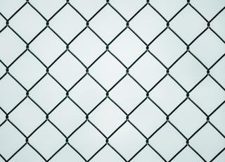 black metal chain link fence
