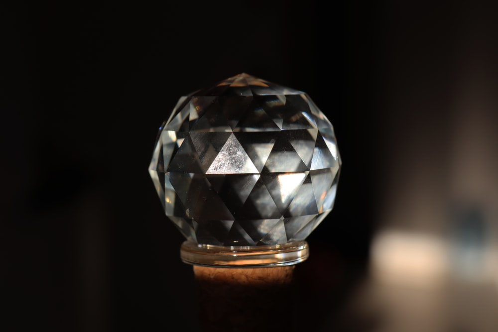 silver diamond on brown wooden stand