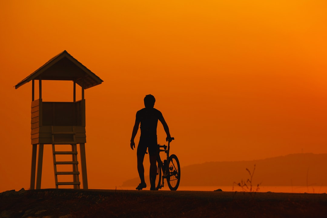Biker over sunrise.