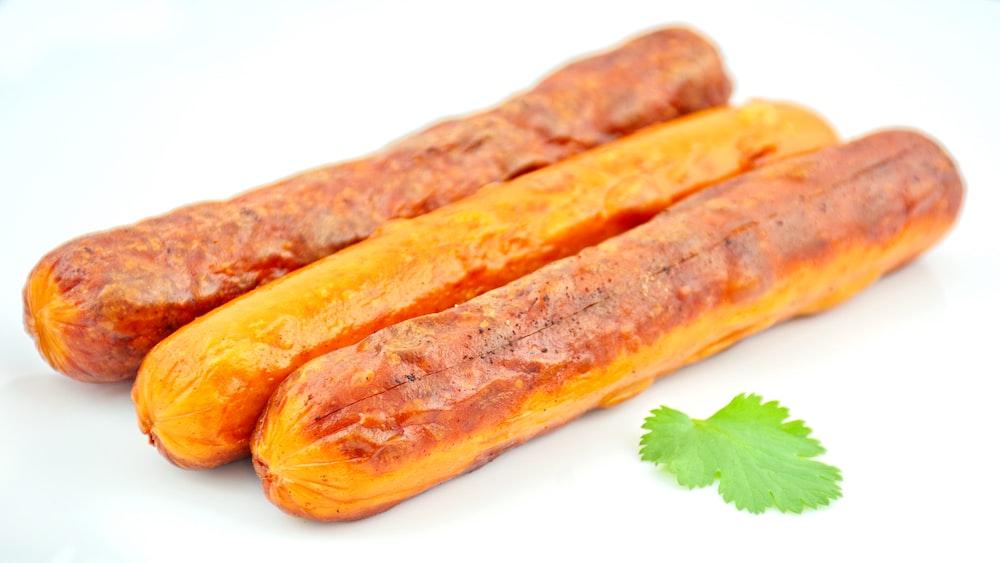 brown sausage on white plate
