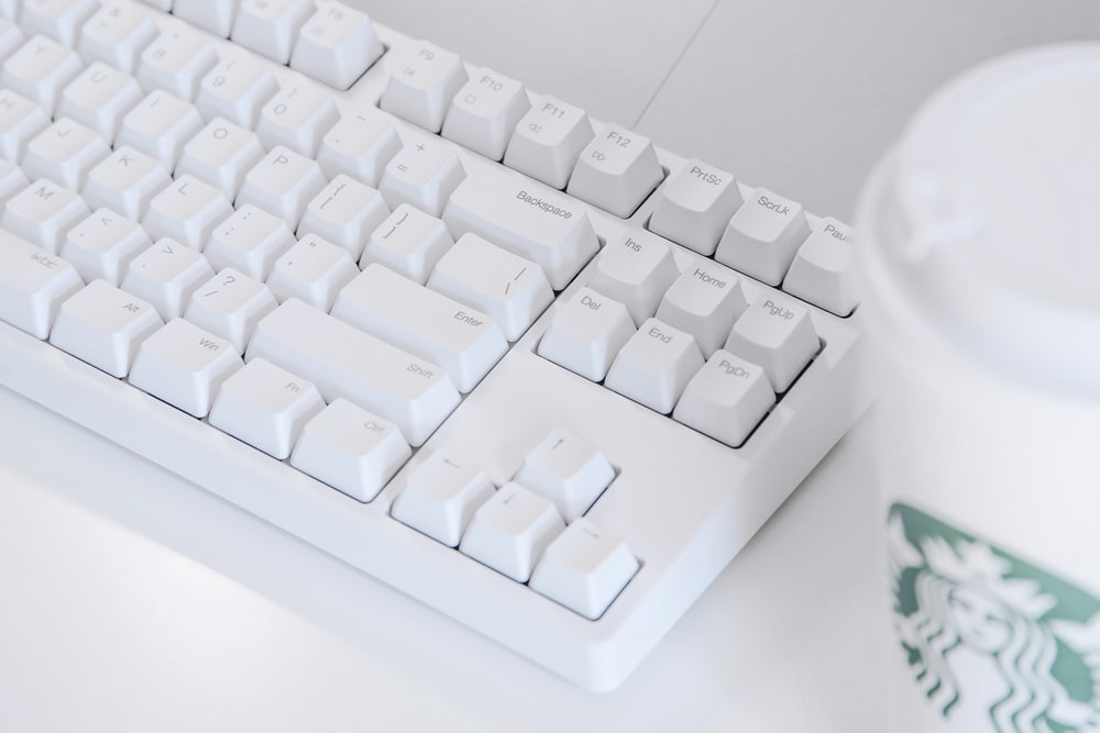 white computer keyboard on white table