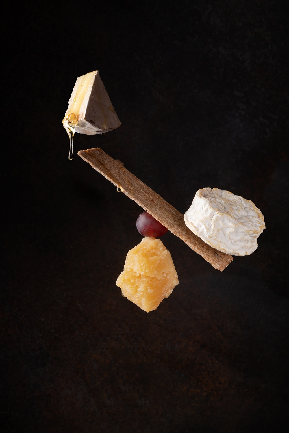 brown wooden stick beside white stone