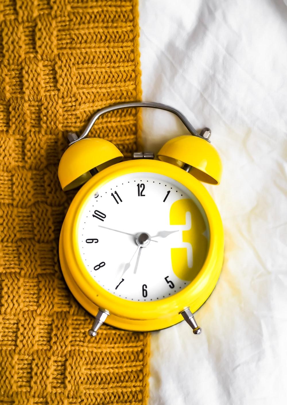 yellow and white alarm clock at 10 10