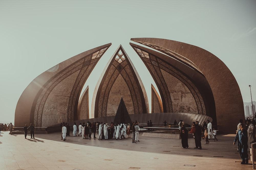 people walking on brown concrete building during daytime