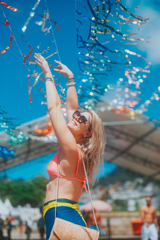 woman in red bikini top and black sunglasses