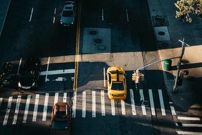 yellow car on pedestrian lane during daytime asphalt zoom background