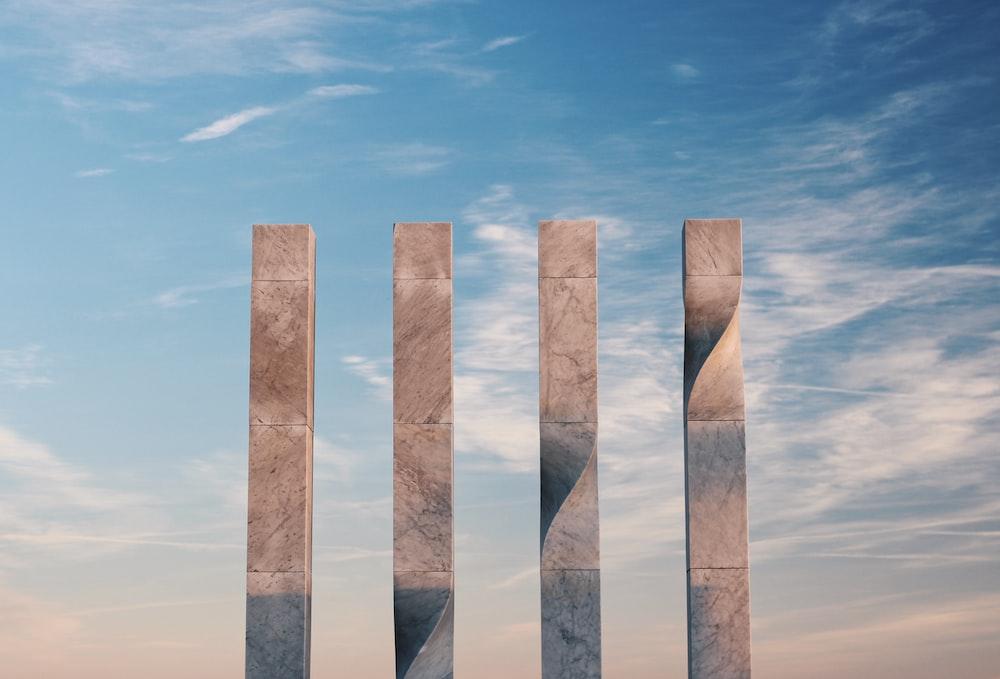 brown wooden poles under blue sky during daytime