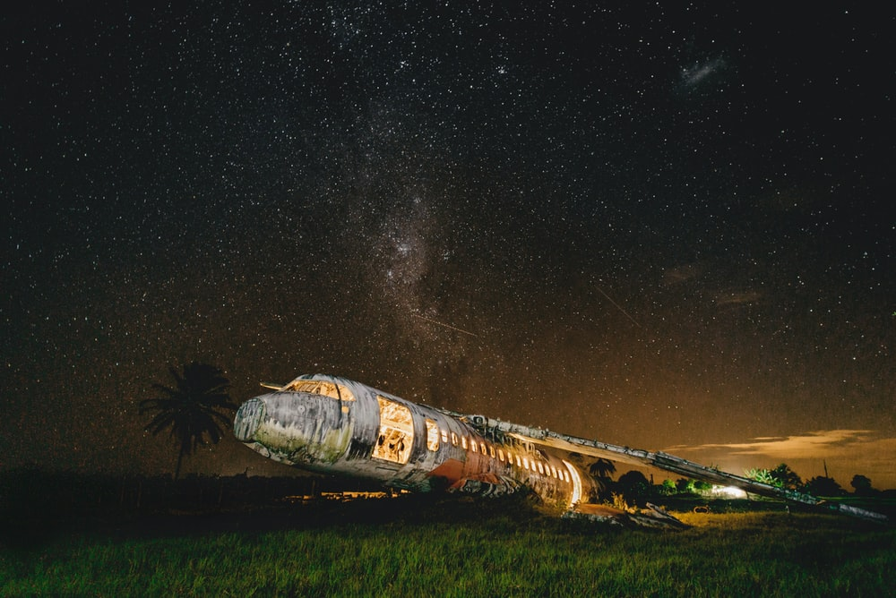 brown and white space ship on green grass field during night time