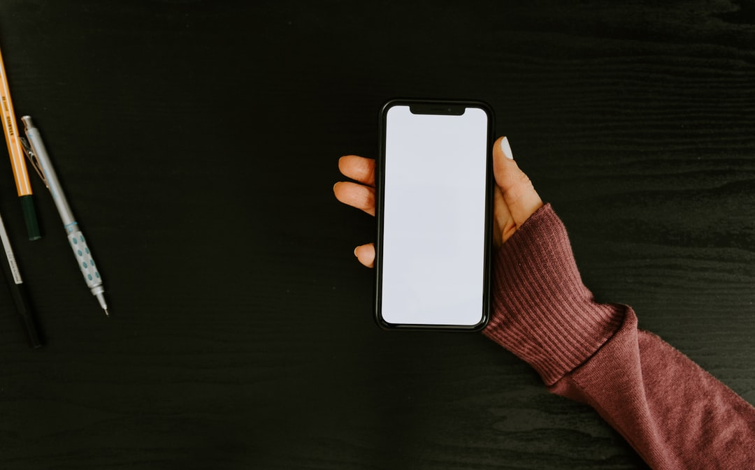 Woman's hand holding phone with blank screen
