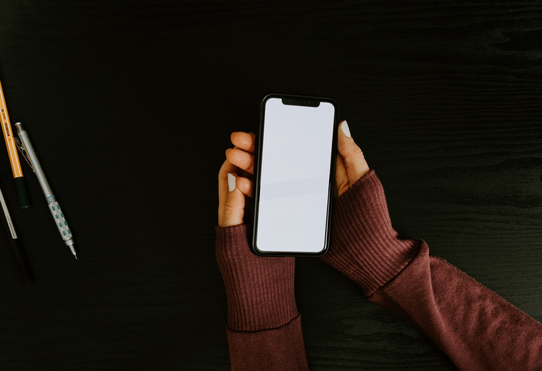 Woman's hands holding phone with blank screen
