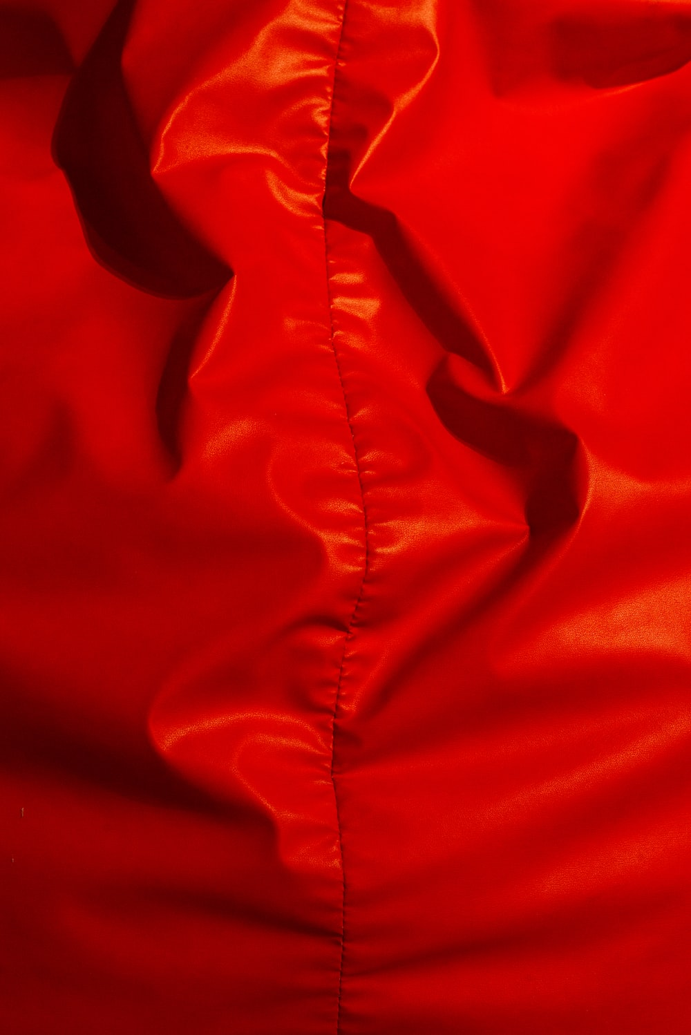 red textile on white textile