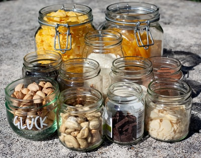 clear glass jars with white and brown stones