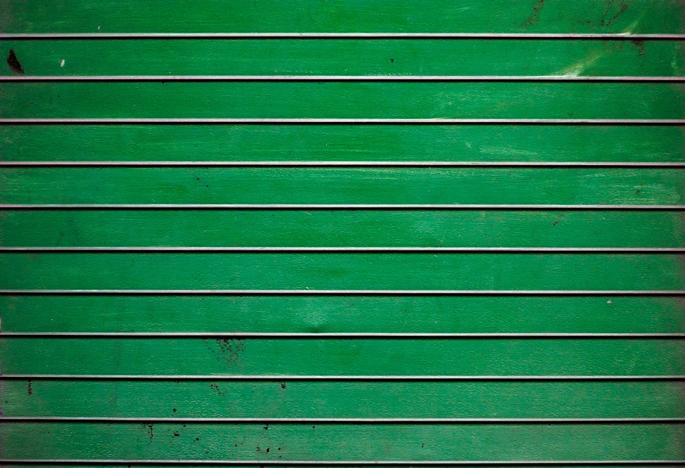 green wooden wall during daytime