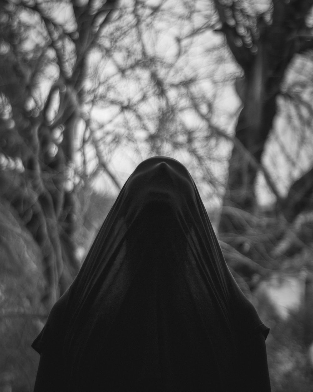 grayscale photo of person in black hijab