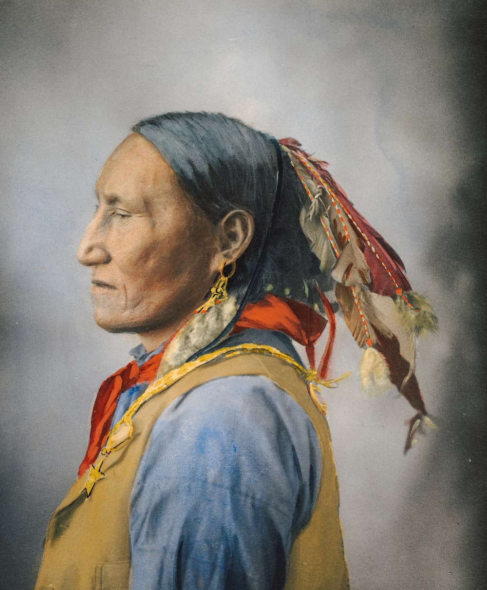 woman in yellow and blue shirt painting