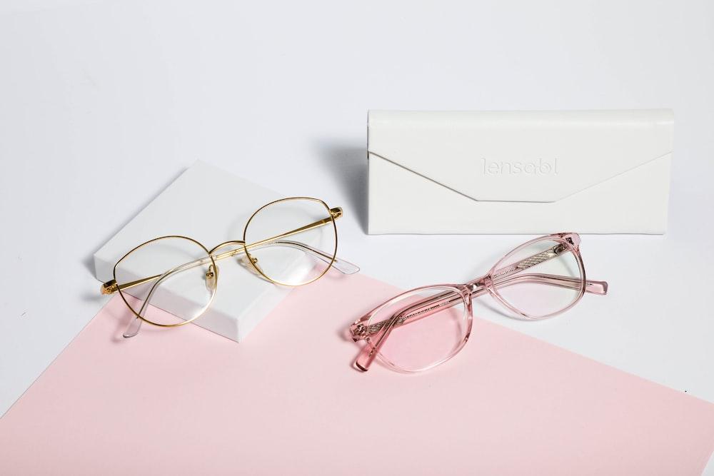 gold framed eyeglasses on white paper