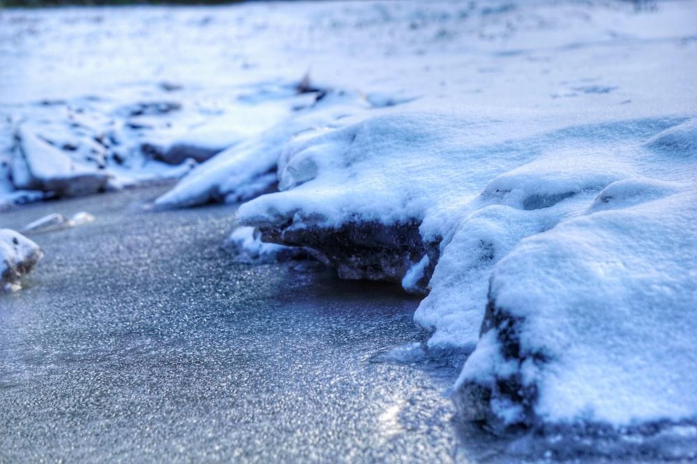 white ice on gray sand