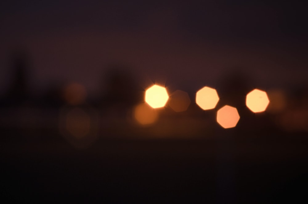 bokeh photography of sun during sunset