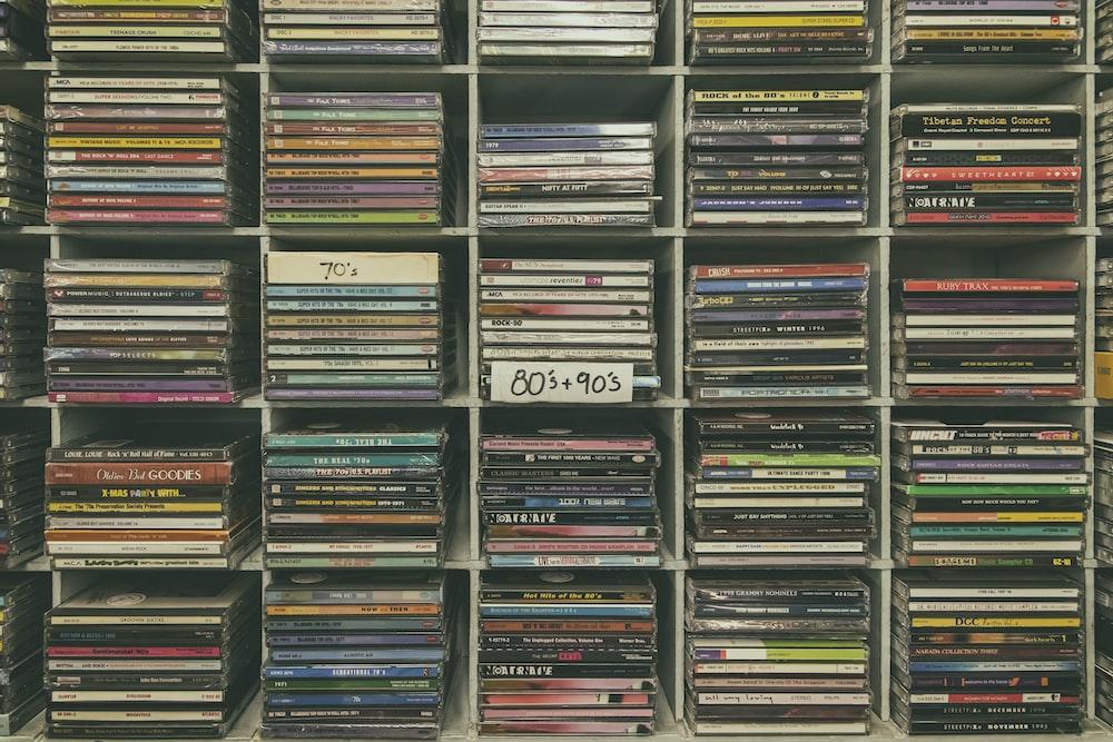 assorted books on black wooden shelf