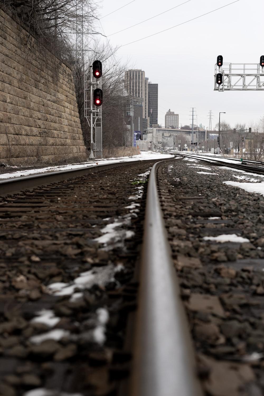train rail near brown brick wall