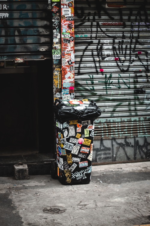 black white and red trash bin