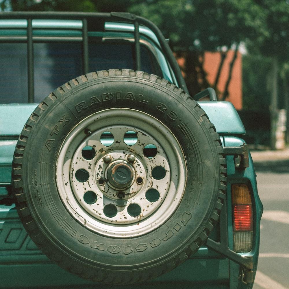 grey 5 spoke car wheel with tire