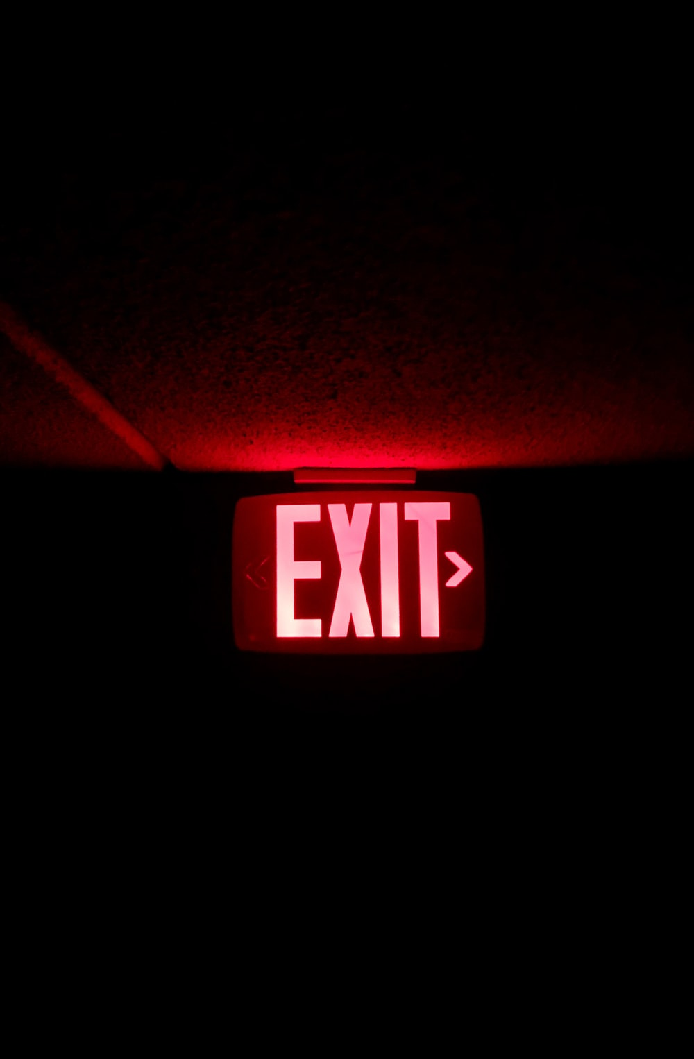red and white UNK lighted signage