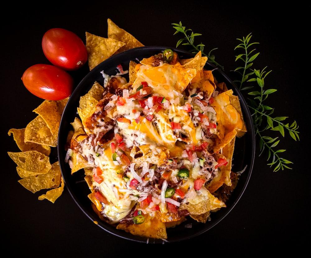 black ceramic bowl with dish, nacho recipe