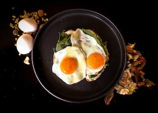 sunny side up egg on black ceramic plate