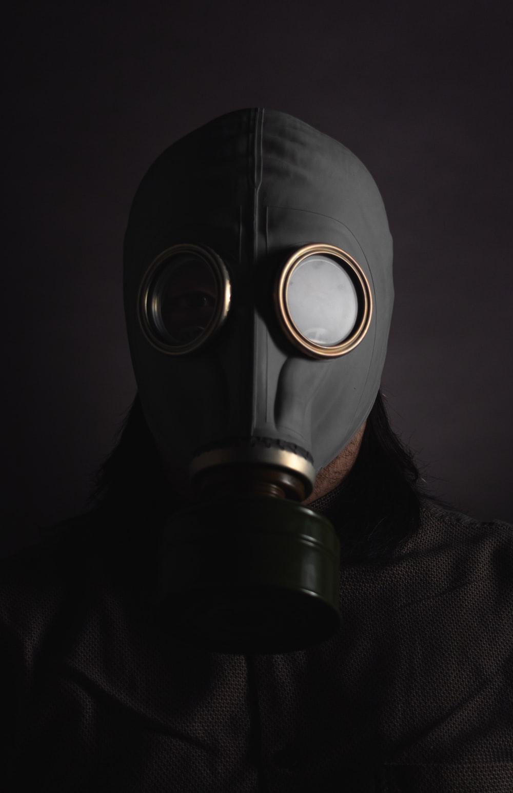 person wearing black gas mask