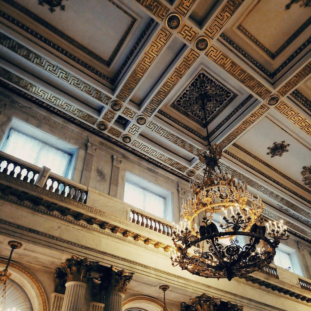 gold uplight chandelier on ceiling