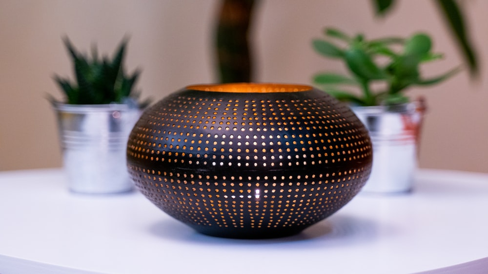 black and gold ball on white table