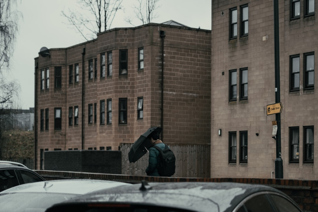 Man walking with an umbrella