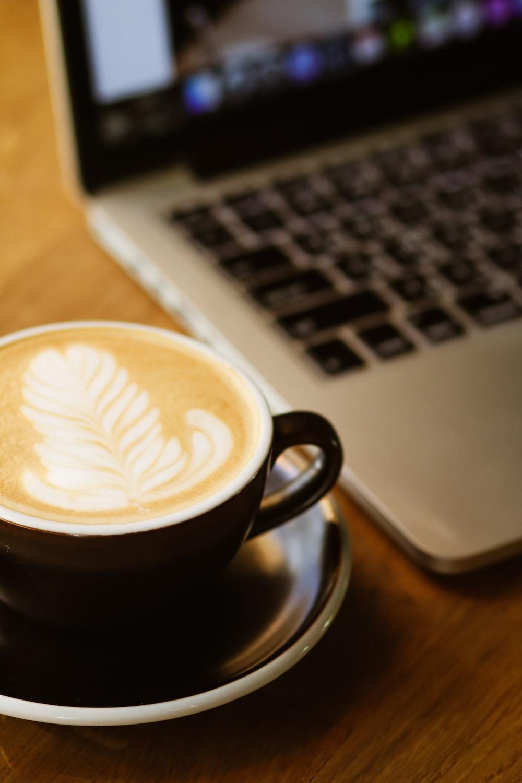 black ceramic mug with cappuccino