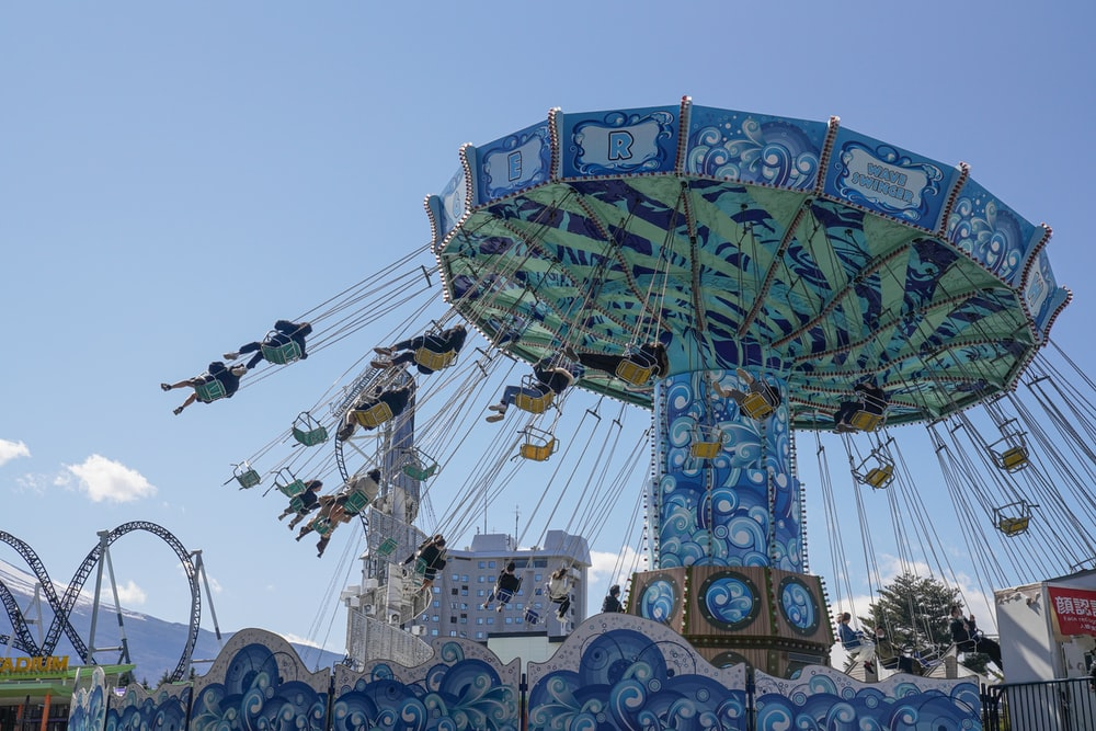 blue and green ferris wheel under blue sky during daytime