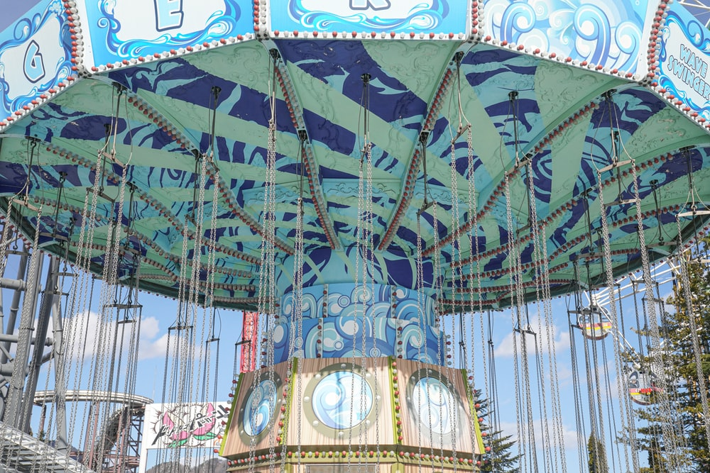 blue and white carousel during daytime