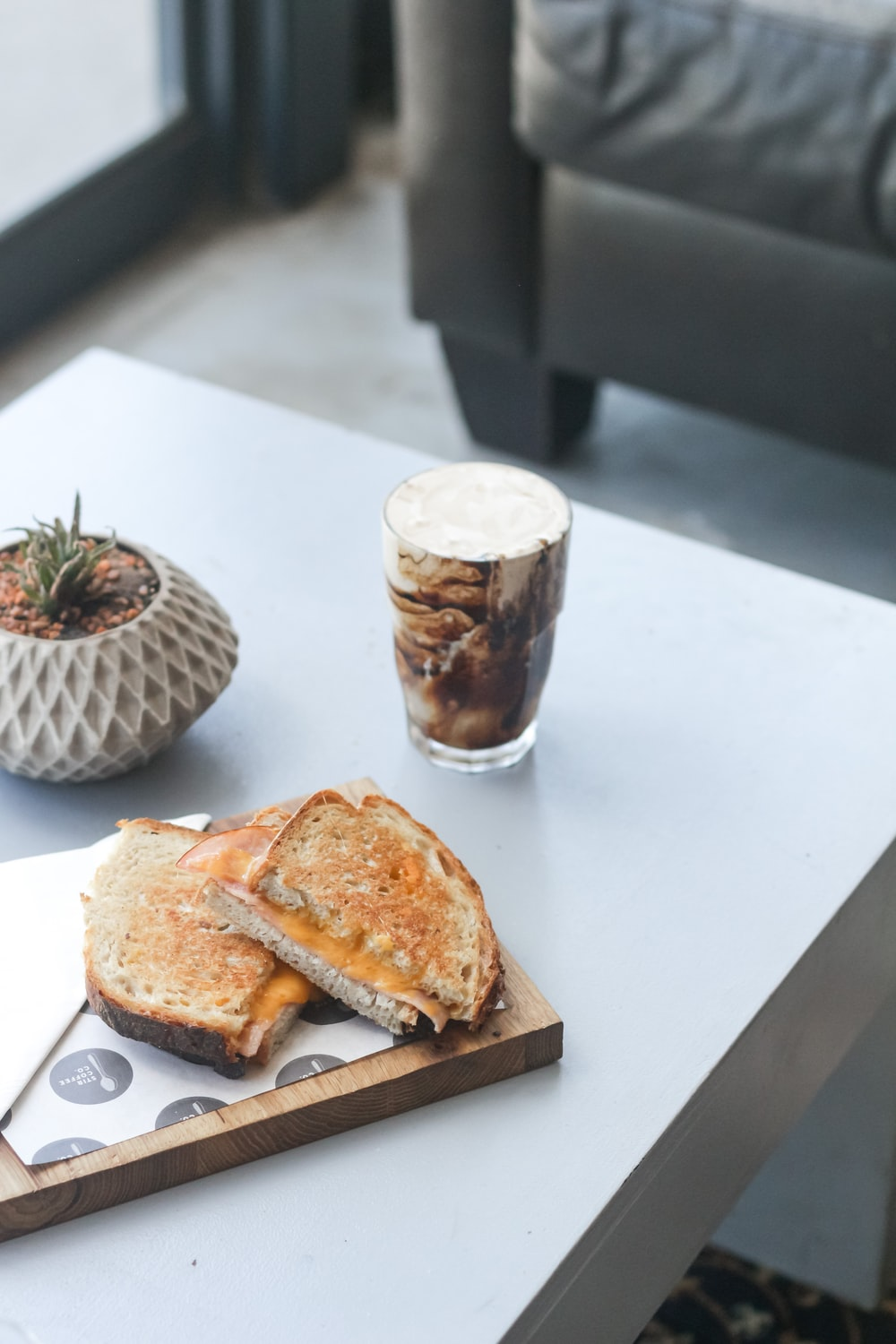 bread on white ceramic plate beside clear drinking glass