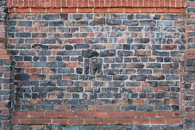 brown brick wall with black and white wall paint