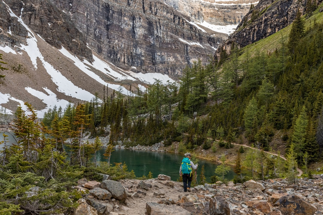 unsplash.com/@catmillerphotos Hiking along the Big Beehive Trail next to Lake Agnes, a 3km hike up from Lake Louise, Banff, Canada