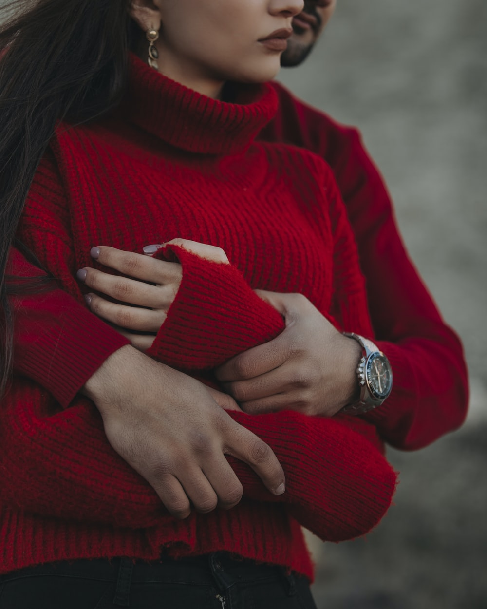 woman in red sweater wearing silver ring