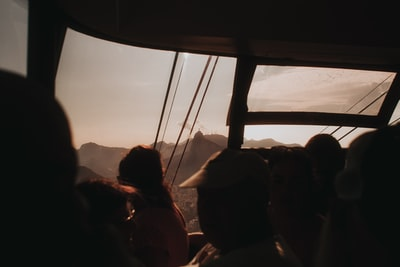 silhouette of people sitting on chair during sunset rio de janeiro teams background