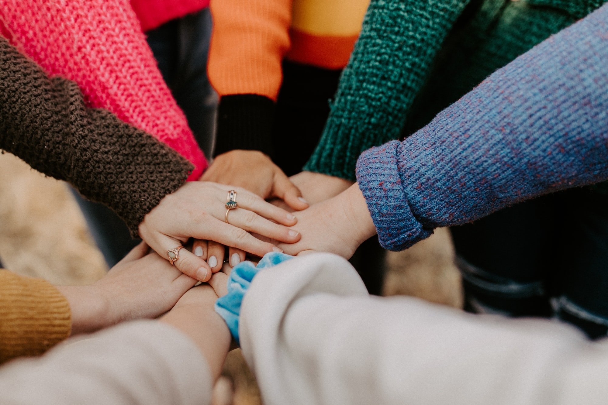 community hands together