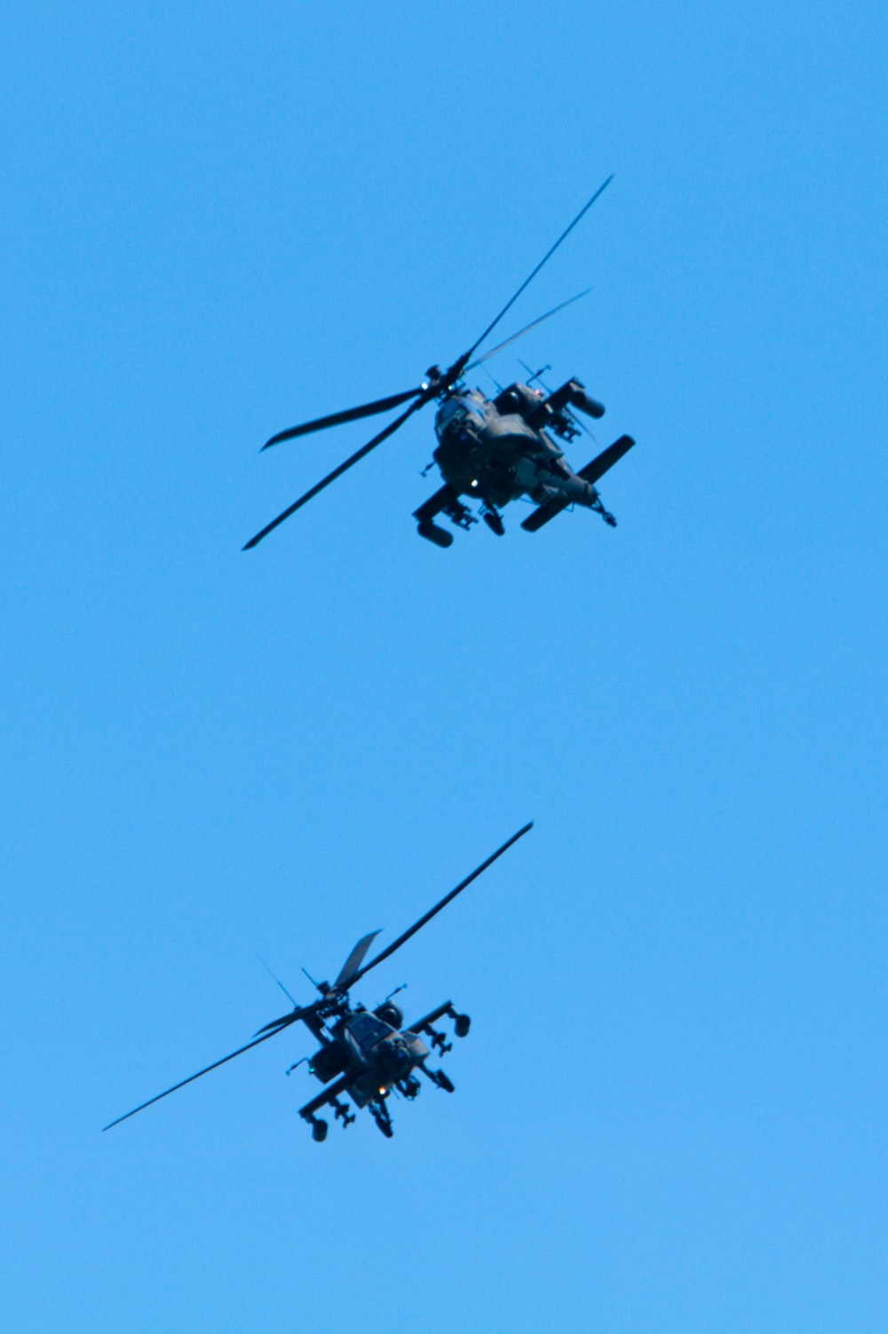 black and gray helicopter in mid air