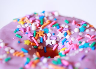 pink and white ice cream with sprinkles