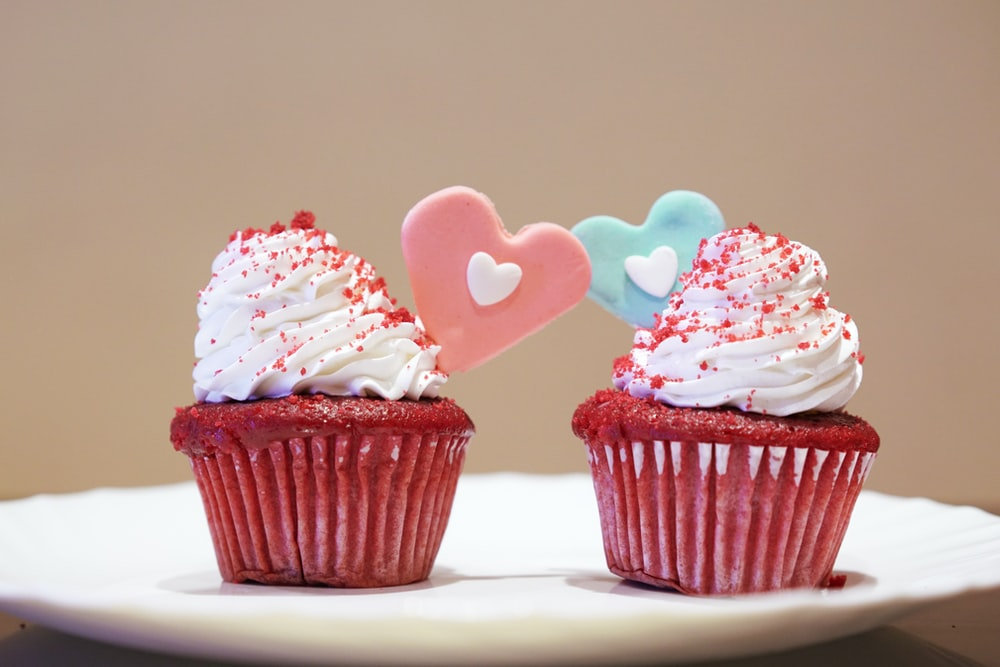 2 cupcakes with white icing on top